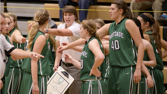 Hailey Crane (40) is the only senior for the 15-1 Mountain Heritage girls basketball team coached by Susie Shelton.