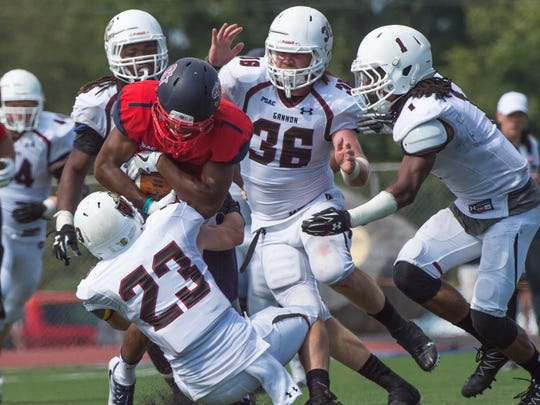 Shippensburg's Erik Kerns gets tackled by several Gannon defenders during a football game at Seth Grove Stadium on Saturday. Sept. 10, 2016. Gannon defeated the Red Raiders, 20-24.