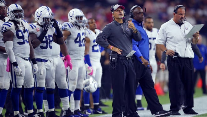 Indianapolis Colts head coach Chuck Pagano looks up to the scoreboard during the second half of an NFL football game Thursday, Oct. 8, 2015, at NRG Stadium in Houston, Texas.