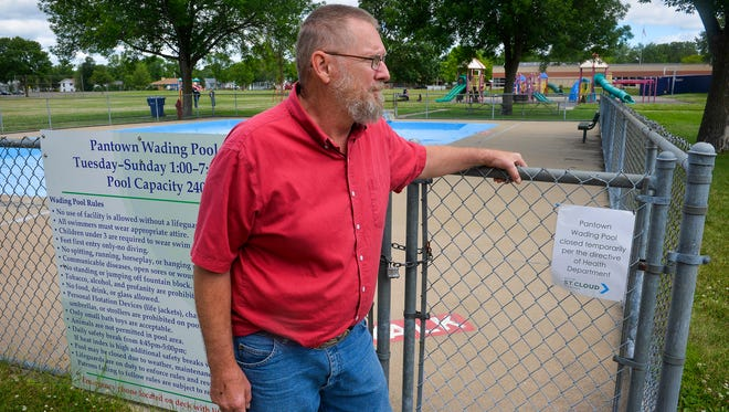 Ron Kornovich talks Tuesday, June 28, about the health department's closure of the Pantown Park wading pool that's situated right across the street from his home. He said the pool was frequently full on warm summer days but if the city isn't going to keep it up any more, it should probably be filled in. He sees skateboarders and others inside the low fence despite its closure.
