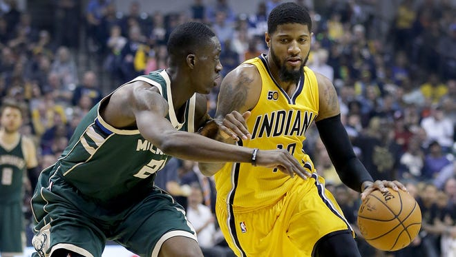 Indiana Pacers forward Paul George (13) looks to drive on Milwaukee Bucks guard Tony Snell (21) in the first half of their game Saturday, February 11, 2017, evening at Bankers Life Fieldhouse.