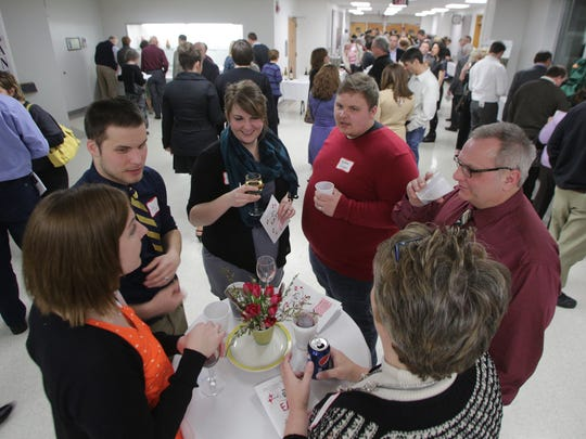 From left, Melissa and Dan Linden, Wausau, Ashley and Matthew Rhyner, Fond Du Lac, and John and Kim Rhyner, Wausau, chat and drink before the tasting portion of EATS, Saturday, March 1, 2014, at UWMC in Wausau.