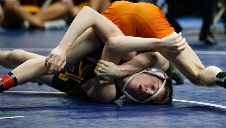 Valley's Nick Oldham wrestles Caleb Rathjen of Ankeny