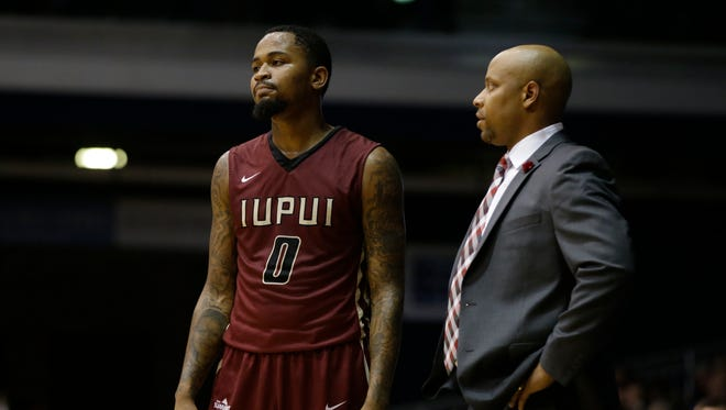 Coach Jason Gardner talks with Darell Combs (0), IUPUI's leading scorer from a year ago.