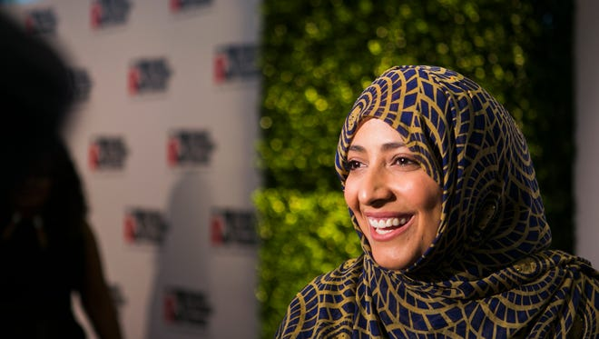 October 20, 2016 - Tawakkol Karmen, a Nobel Peace Prize Laureate, listens to a reporter's question as she walks on the red carpet during the 25th Freedom Award ceremony at the Cannon Center for the Performing Arts on Thursday. Karmen received a Freedom Award at the event hosted by the National Civil Rights Museum.