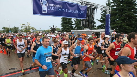 Runners encountered some wet conditions during the 2016 Lakefront Marathon.