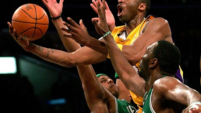 From Feb. 23, 2007, Los Angeles Lakers' Kobe Bryant, top, goes up for a shot between Boston Celtics' Paul Pierce, left, and Al Jefferson during the first half of an NBA basketball game in Los Angeles. Bryant was one of eight finalists announced Friday, Feb. 14, 2020, as candidates for enshrinement into the Basketball Hall of Fame later this year, a decision that came as absolutely no surprise in his first year of eligibility.