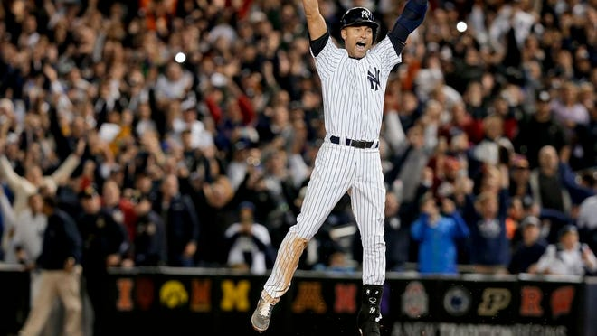 From Sept. 25, 2014, New York Yankees' Derek Jeter jumps after hitting the game-winning single against the Baltimore Orioles in the ninth inning of a baseball game, in New York. Derek Jeter is among 18 newcomers on the 2020 Hall of Fame ballot, announced Monday, Nov. 18, 2019, and is likely to be an overwhelming choice to join former New York Yankees teammate Mariano Rivera in Cooperstown after the reliever last year became the first unanimous pick by the Baseball Writers' Association of America.