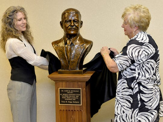 Sculptor Tracy Sugg, left,  of Wartrace and MTSU alumna