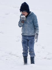 Liam Doyle eats snow at Betty Virginia Park in Shreveport,
