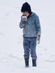 Liam Doyle eats snow at Betty Virginia Park in Shreveport,