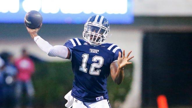 JSU quarterback Brent Lyles passes as Southern defenders close in