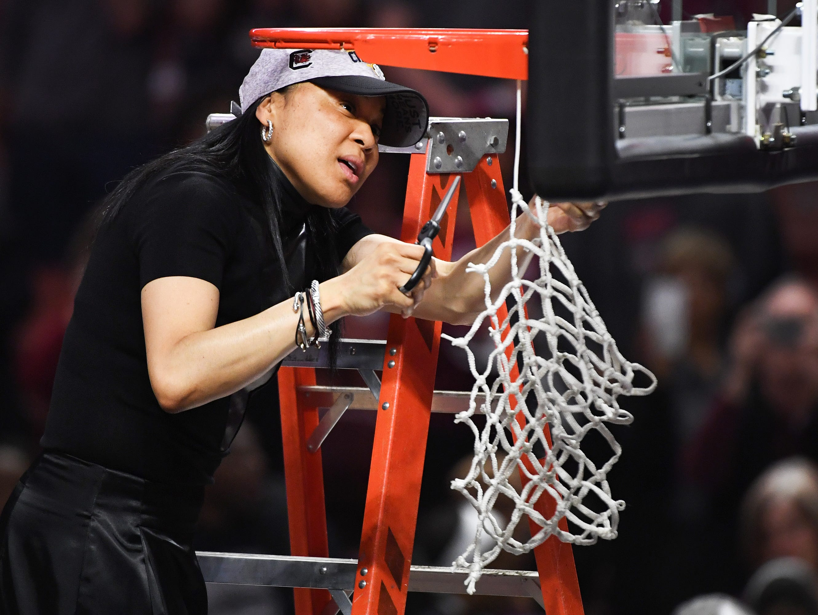 South Carolina head coach Dawn Staley cuts down the net following the SEC Championship at Bon Secours Wellness Arena on Sunday, March 5, 2017.
