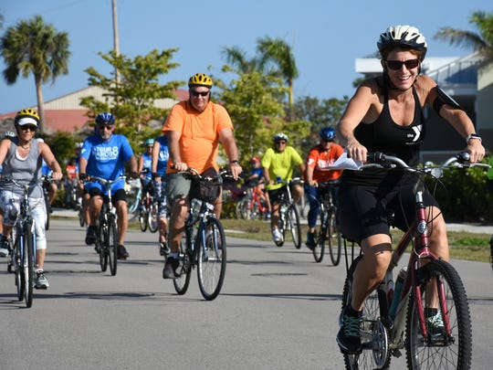 Group leader Stacy Witthoff shows the route.The eighth annual Tour de Marco saw 175 cyclists biking all around Marco Island on Sunday morning.
