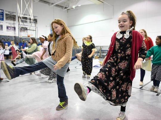 """South Heights Elementary students Baylee Pressley (left) and Lena Floyd practice a dance number Tuesday morning during a rehearsal of the school drama department's production of """"Annie Jr."""""""