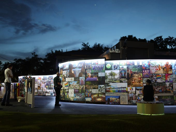 People visit the memorial to the 49 shooting victims