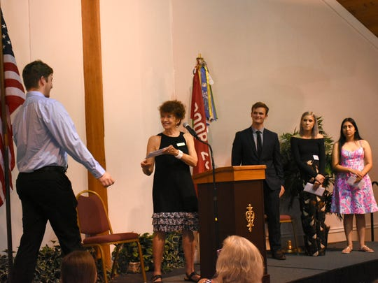 Carolyn Burger presents a scholarship to winner Logan Fischer, joining Joseph Byrne, Anastasia Baran and Brenda Perez. MIFA, the Marco Island Foundation for the Arts, awarded their Artist of the Year designation and student scholarships on Saturday during a luncheon at Wesley United Methodist Church.
