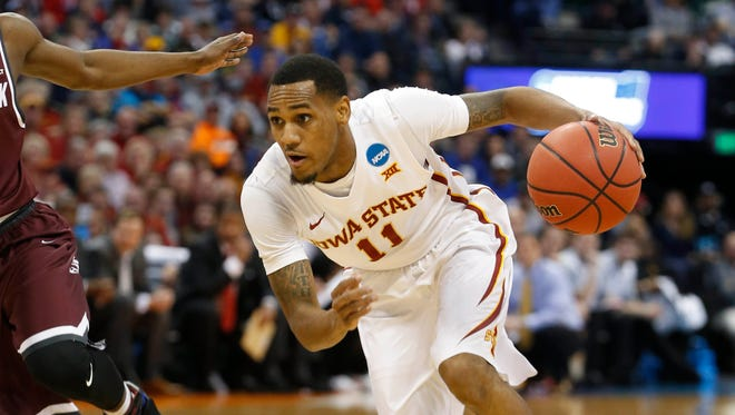 Iowa State guard Monte Morris (11) drives past a Little Rock defender Saturday, March 19, 2016, during the second round of the NCAA men's basketball tournament at the Pepsi Center in Denver.