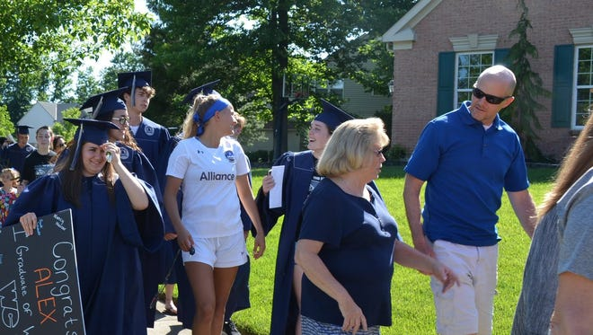 Classmates, teachers and administrators prepare to surprise senior Alex Click with a special celebration. Click was unable to attend senior awards or graduation.
