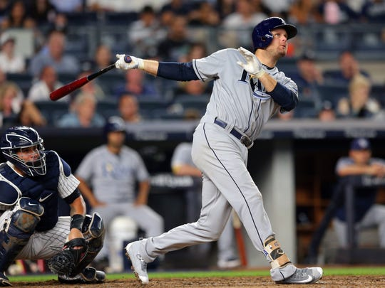 Tampa Bay Rays first baseman Lucas Duda (21) follows through on a solo home run against the New York Yankees during the seventh inning at Yankee Stadium on Friday, July 28, 2017. It was Duda's first homer as a Ray, one day after getting traded from the Mets.