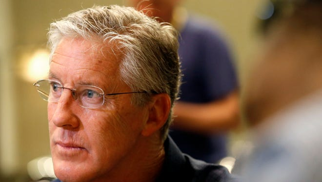 Seattle Seahawks head coach Pete Carroll listens to a question as NFC football coaches meet with the media during the NFL's annual meeting, Wednesday, March 25, 2015, in Phoenix.