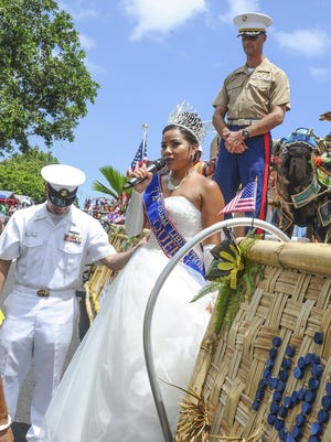 Liberation Queen Alana Chargualaf addresses the crowd during the 72nd Liberation Day Parade on Marine Corps Drive on July 21, 2016.