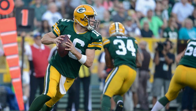 Packers quarterback Scott Tolzien rolls out in the first quarter of a preseason game against the Saints.