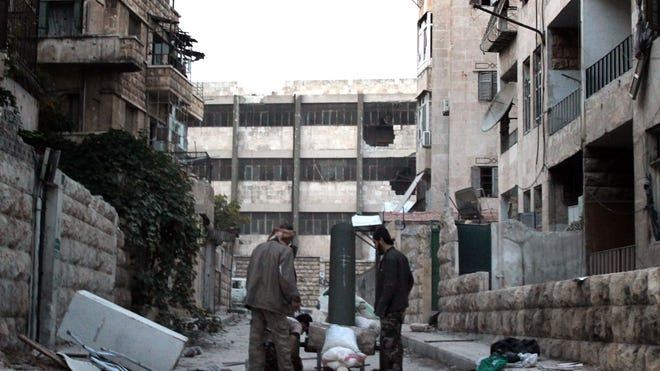 Opposition fighters prepare a homemade cannon during clashes with regime forces in Syria's northern city of Aleppo.