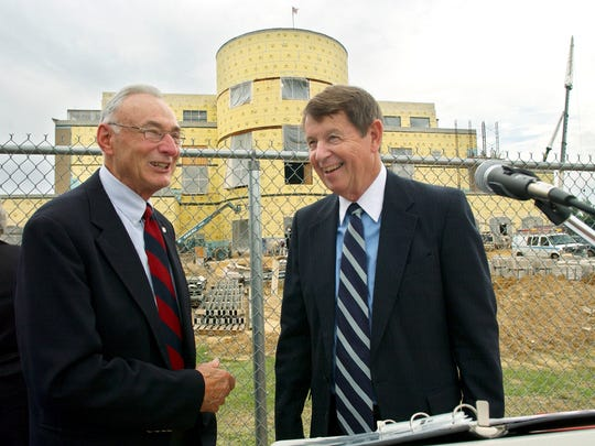 Former USI president David L. Rice, left, jokes with then president H. Ray Hoops (cq) during a cornerstone placement ceremony on the USI campus in conjunction with the university's 40th birthday. The cornerstone, which contained a time capsule, was placed at the construction site of the David L. Rice Library, background.