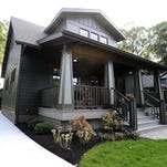 A screen-in porch addition is attached to the garage in Ann Arbor's Water Hill neighborhood.
