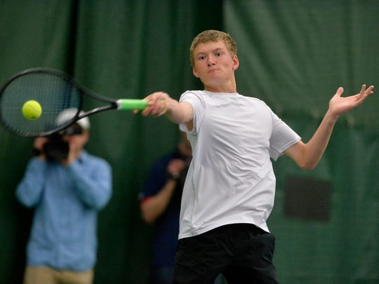 Great Falls Central's Nicholas Scott makes a forehand