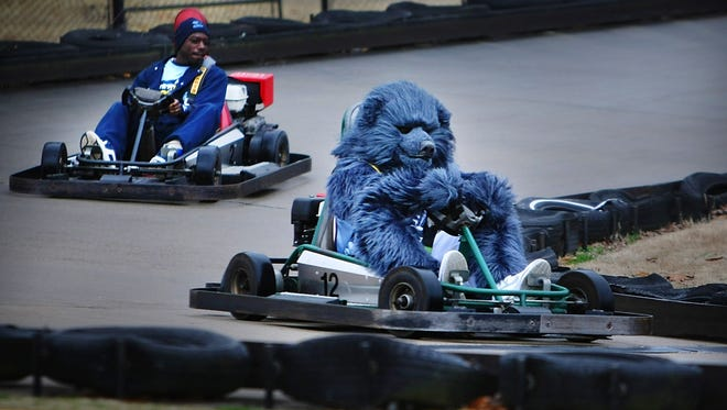 Memphis Grizzlies mascot The Grizz takes a turn on the go-carts at the Golf and Games Family Park in 2010. About 300-400 kids stampeded and rioted at the golf and games venue Saturday. (Photo by Jim Weber/The Commercial Appeal)