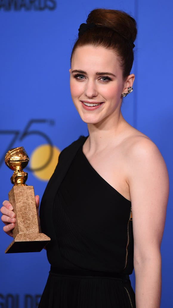Rachel Brosnahan poses with her Golden Globe for best