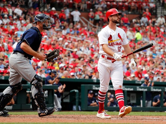 Paul DeJong,  walks away after striking out in the