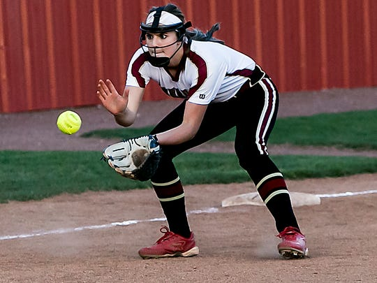 Riverdale's third baseman Macy Murphy fields the ground ball and makes the play at first for the out.