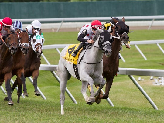 World Approval (No. 4), grabs the lead on the far turn on his way to winning the Grade I $300,000 United Nations Stakes Sunday at Monmouth Park