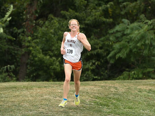 Ellie Keck's runner-up finish helped the Palmyra girls win the team title at the Lebanon County Cross Country Championships.