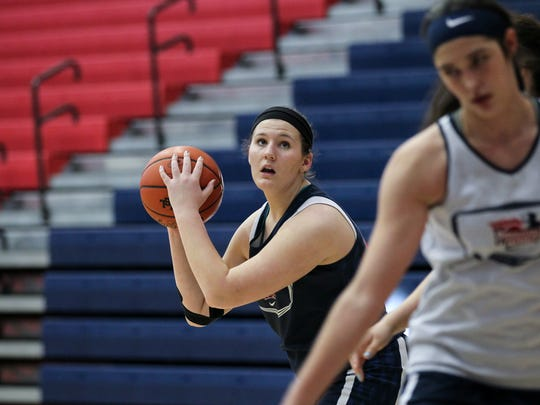 Kaitlyn Carpenter, a senior girls basketball player at Powdersville High School, practices shooting in the paint near a teammate.