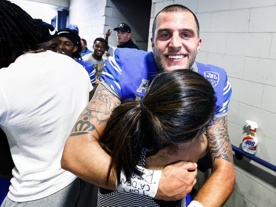 University of Memphis quarterback Riley Ferguson celebrates with fans after lead the Tigers to a 45-48 victory over national ranked UCLA at The Liberty Bowl Memorial Stadium in Memphis, Tennessee., Friday, September 16, 2017.
