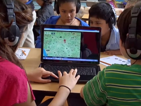 Children play the online game Mission US, which is