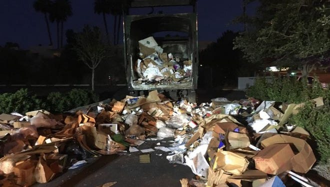 A Scottsdale Fire official said a man was pulled from the back of this garbage truck after the driver heard screaming Feb. 9, 2017. The man had been sleeping in a recycling container.