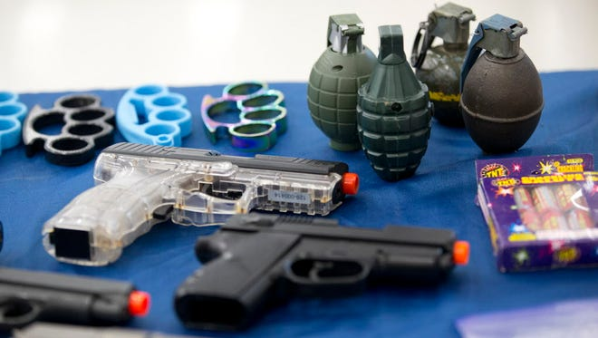 A small selection of items confiscated from passengers in 2015 by the Transportation Security Administration is displayed during a news conference at the Fort Lauderdale-Hollywood International Airport on Dec. 18, 2015.