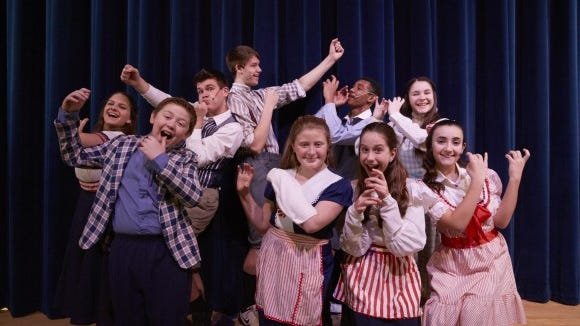 Will these excited young people actually get to play in a band? Find out for yourself when the Webster Theatre Guild presents The Music Man. (John Myers)