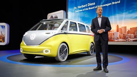 Volkswagen's Herbert Diess shows off the I.D. Buzz concept van at the Detroit auto show in 2017.