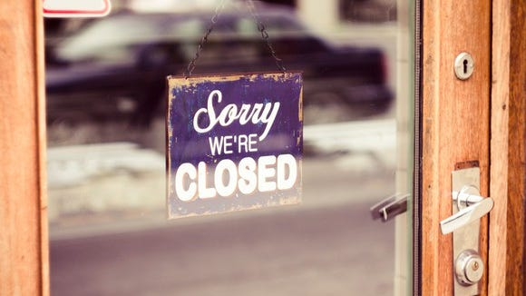 "Picture of a sign on a door that says ""Sorry, we're closed."""