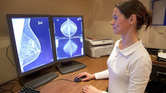 Woman looking at mamogram