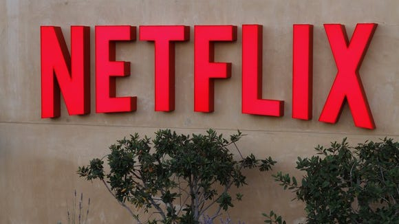 Red Netflix logo on a stucco wall