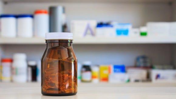 Medicine bottle on pharmacy counter