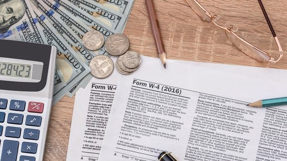 W-4 form for withholding, along with cash and a calculator with pencils and pens.