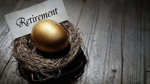 Golden egg labeled retirement in nest